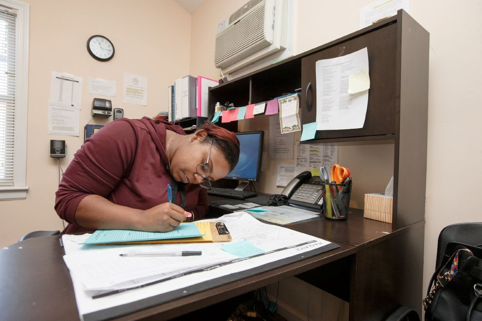 Staff member Karina Foster of Hartford work in the office Thursday at the Bridge Family Center Winifred House in Southington. The home provides services to young women in the Short Term and Respite or S.T.A.R. program for transition to foster homes or reunification. February 8, 2018 | Justin Weekes / Special to the Record-Journal