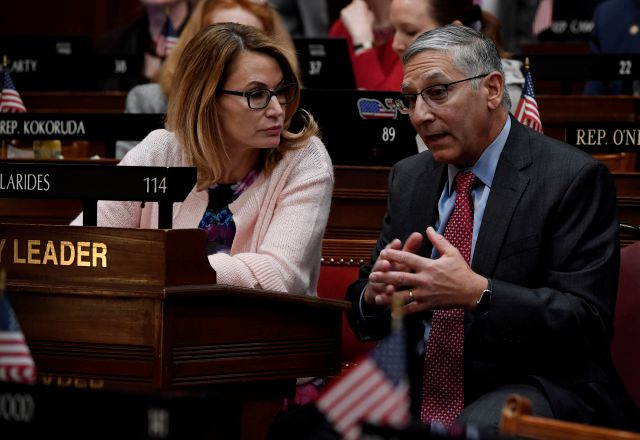 Connecticut House Minority Leader Themis Klarides, R-Derby, left, talks with Senate Minority Leader Len Fasano, R-North Haven, before Connecticut Gov. Ned Lamont delivers his budget address at the State Capitol in Hartford, Conn., Wednesday, Feb. 20, 2019. (AP Photo/Jessica Hill)