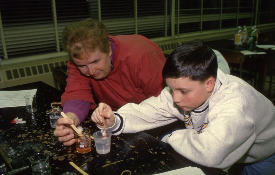 RJ file photo - Rita Lecuyer and her son Eric, an eighth-grader at Lincoln Middle School, try an experiment to determine the time it takes for various sugar crystals to dissolve March 4, 1994. The experiment was part of the school