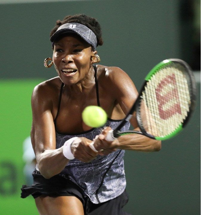 Venus Williams, of the United States, returns a shot against Angelique Kerber, of Germany, during a quarterfinal match at the Miami Open tennis tournament, Wednesday, March 29, 2017, in Key Biscayne, Fla. Williams defeated Kerber 7-5, 6-3. (AP Photo/Mario Houben)
