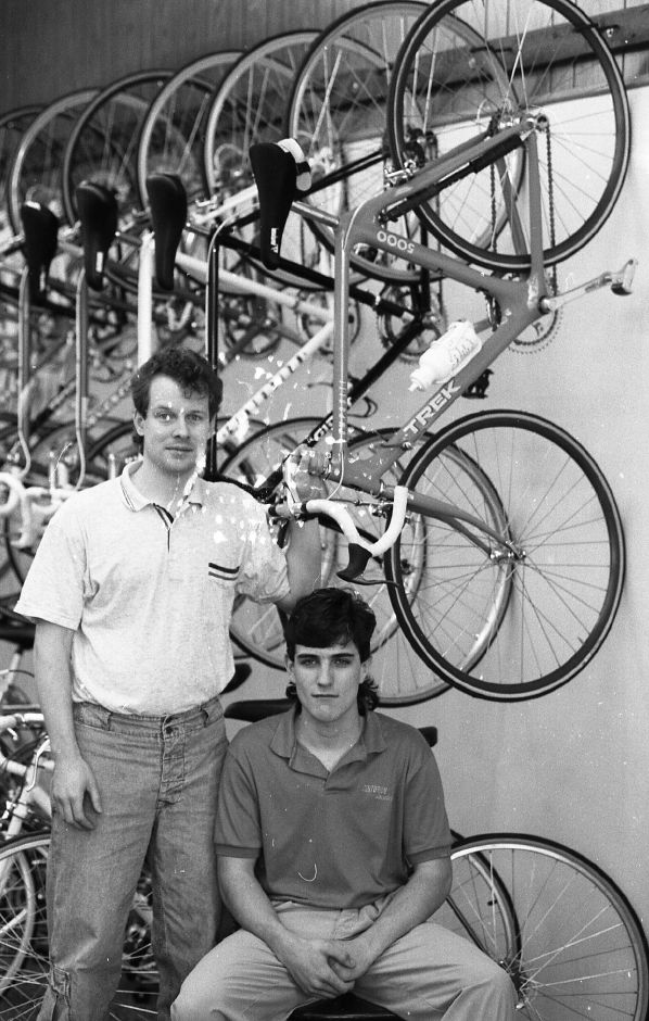 RJ file photo - Alpha-Lo Bicycles owner George Dickerson, left, is organizing a new bicycle race for avid bikers. Jerry Braga is the store