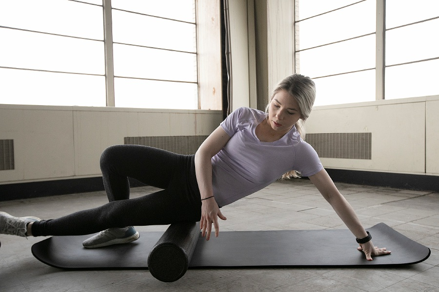 Kristen Dearborn, of Wallingford, uses a foam roller to work her  muscles.Photos by  Dave Zajac, Record-Journal
