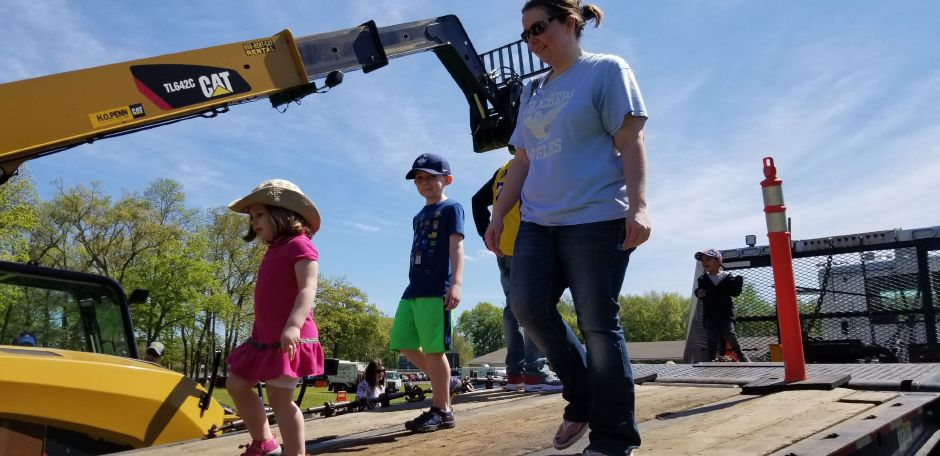Christine Young with Lily, 3, and Ben, 6, walk down a flatbed truck at the 17th annual Touch-a-Truck event at the Southington Drive-In, at 995 Meriden-Waterbury Turnpike, on Saturday, May 18, 2019. Photos by Jeniece Roman, Record-Journal