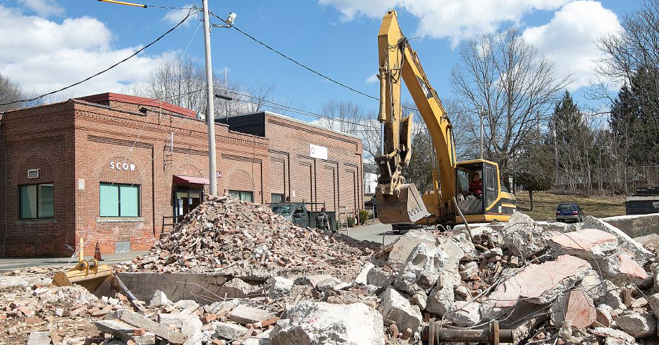 Crews continue demolition of the former Civil Defense building next to the Spanish Community of Wallingford, left, Mon., Mar. 18, 2019. Dave Zajac, Record-Journal