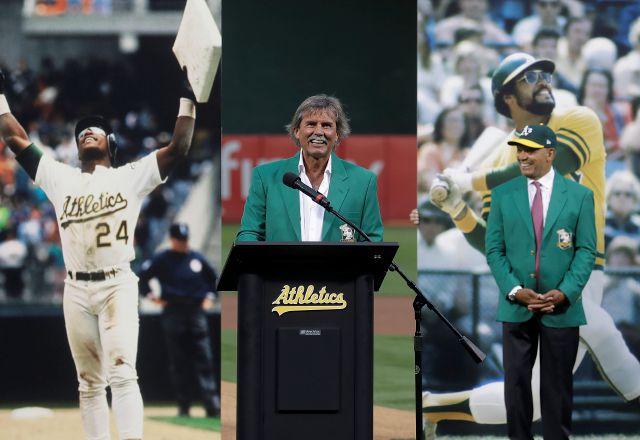 Former pitcher Dennis Eckersley, center, speaks during a ceremony inducting him into the Oakland Athletics