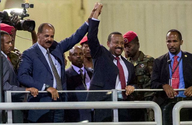 FILE - In this Sunday July 15, 2018 file photo, Eritrean President Isaias Afwerki, second left, and Ethiopia