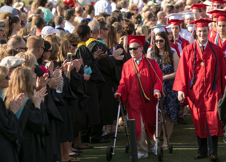 Graduate Matthew Davies, center, receives applause during the procession into graduation ceremonies at Cheshire High School, Wednesday, June 14, 2017.  | Dave Zajac, Record-Journal