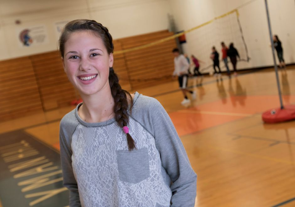 "Lyman Hall junior Meredith DeNegris, 16, poses in the gymnasium at Lyman Hall High School, Monday, Dec. 18, 2017. DeNegris created a new integrative physical education course, ""Unified Physical Education,"" that will offer a physical education curriculum tailored for special education students' needs. Dave Zajac, Record-Journal"