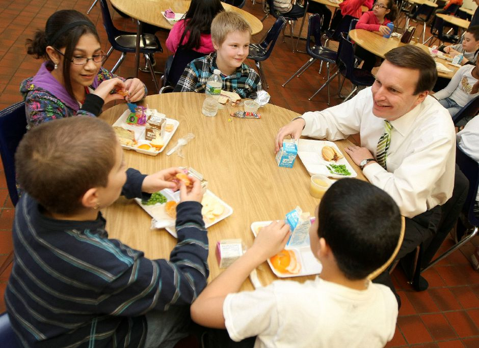 Congressman Chris Murphy eats lunch with Gary Swarz, 10 (top), Sheila Mercado, 11 (left), Joshua Rodriguez, 10 (blue), and Andre Vazquez, 10 (white), at Roger Sherman Elementary School in Meriden on Tuesday December 14, 2010. Murphy had lunch with the 5th graders a day after President Obama signed the new student nutrition law. (Matt Andrew/ Record-Journal)