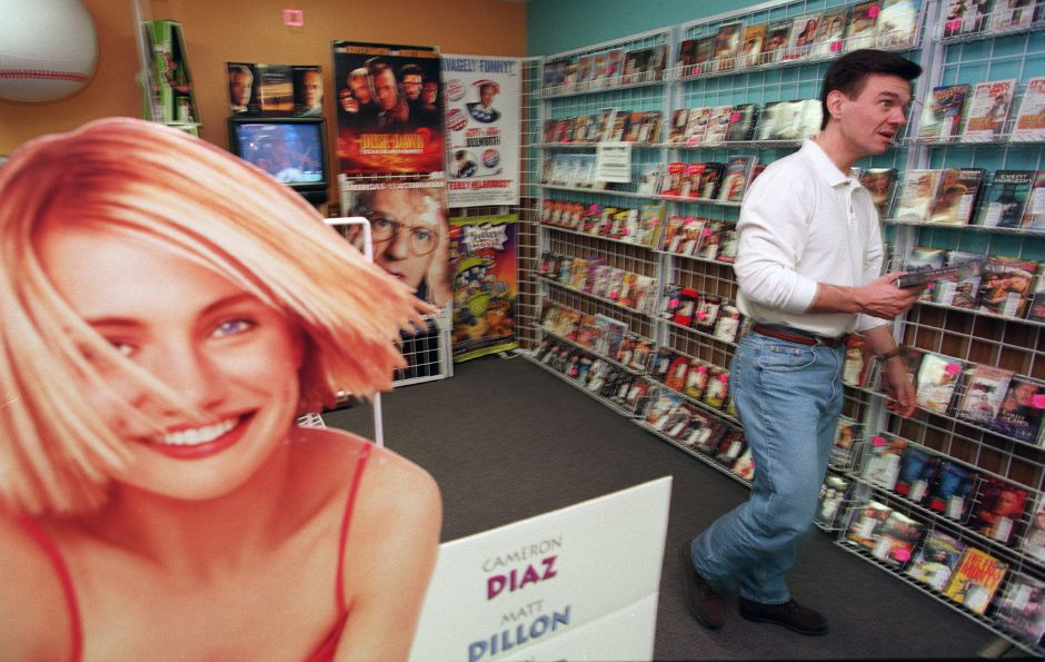 RJ file photo - Mark Tabaka, left, of Meriden, searches for a video at Video Time, 525 W. Main St. in Meriden. The video store has outlasted Blockbuster Video, and owner Robert Ingeno has relocated and expanded the shop, April 1999.