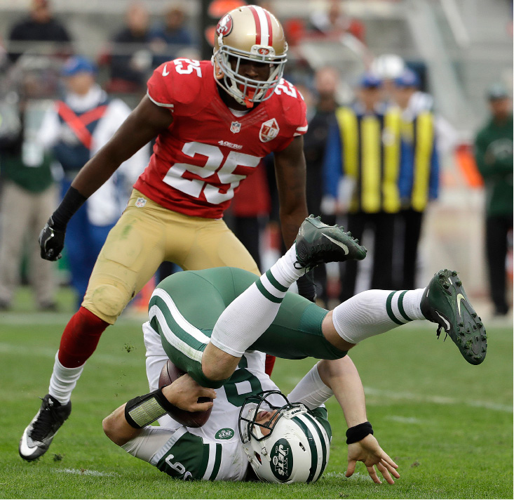 New York Jets quarterback Bryce Petty (9) rolls on his back after being sacked by San Francisco 49ers strong safety Jimmie Ward (25) during the first half of an NFL football game in Santa Clara, Calif., Sunday, Dec. 11, 2016. (AP Photo/Marcio Jose Sanchez)