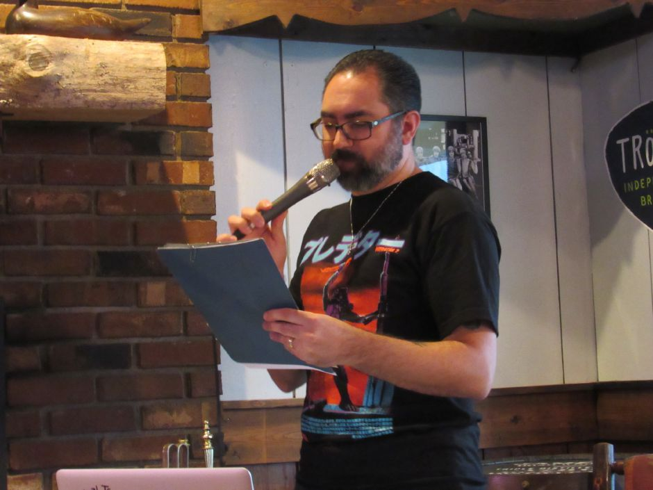 Trivia night host Anthony Apuzzo reads questions about literature at Swift Half bar and restaurant on Tuesday, May 22, 2018. | Lauren Takores, Record-Journal