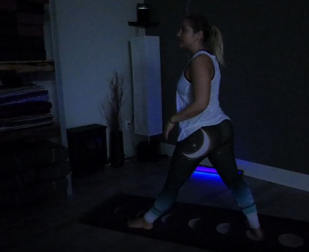Instructor Kallie Meade practices black light yoga at Rise Yoga, 220 N. Colony Rd., Wallingford. |Ashley Kus, Record-Journal