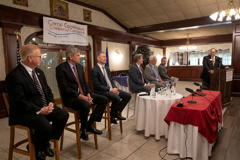 Moderator Paul Lavoie, general manager of Carey Manufacturing, right, speaks during the Central Connecticut Chambers of Commerce Gubernatorial Forum at the Aqua Turf Club in Southington, Thursday, August 9, 2018. Candidates include, left to right, Republican Mark Boughton, Republican Bob Stefanowski, Republican David Stemerman, Republican Steve Obsitnik, Independent Oz Griebel and Democrat Joe Ganim. Dave Zajac, Record-Journal