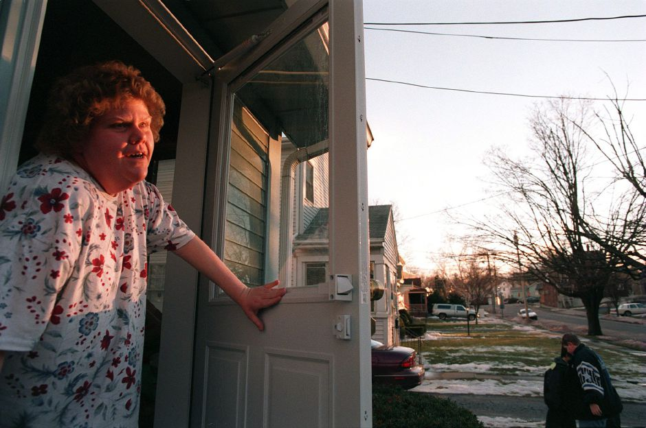 RJ file photo - Kathy Welch-Keezer pokes her head out her front door to talk with a Record-Journal reporter about her street