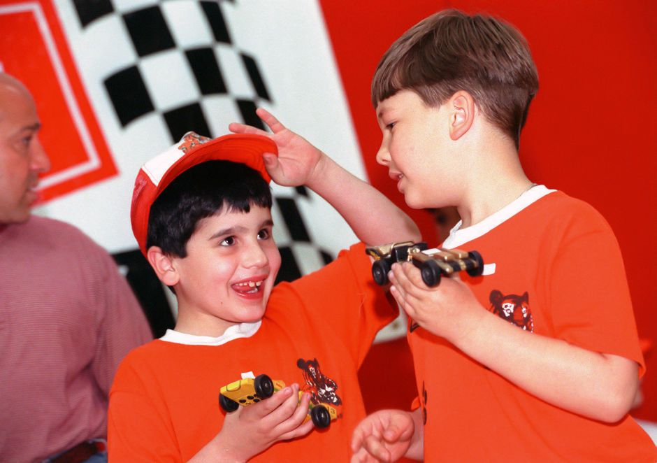 RJ file photo - Andrew Bissell, left, and his friend Kyle Dennen compare cars before competing in the Sleeping Giant District Pinewood Derby finals in Wallingford May 9, 1999.