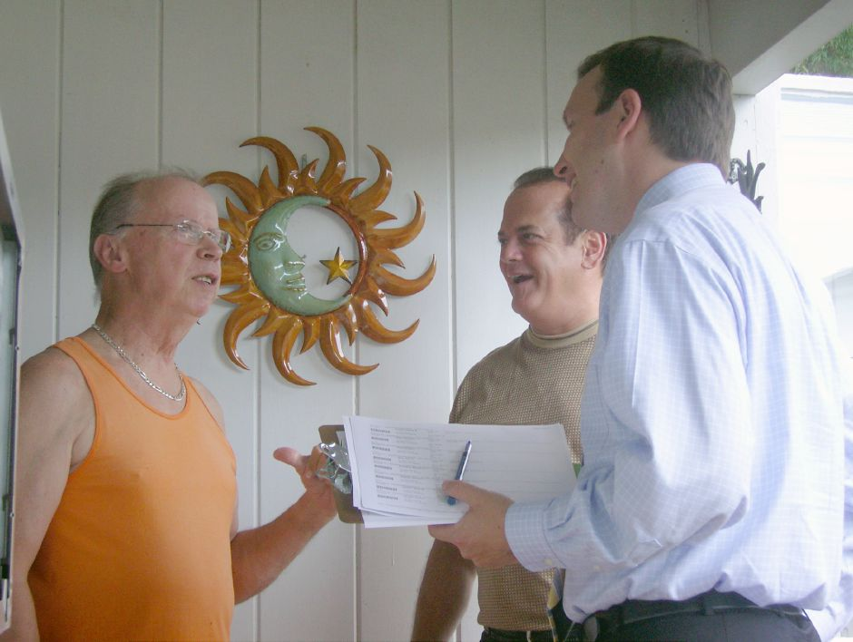 Congressman Chris Murphy, right, and State Sen. Thomas Gaffey, center, chat with Reynolds Drive resident William Knowlton Friday afternoon, August 13, 2010. Murphy was in town to campaign for re-election and drum up support for legislation that will make more federal contracts go to American companies. (Dan Ivers / Record-Journal
