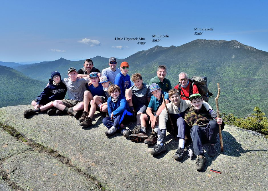 Troop 41 scouts and scout leaders along the Franconia Ridge in the White Mountains of New Hampshire. Front row, from left: Mason Asklar, Colin Asklar (adult leader), Tyler Barber, Jayson Hoyt, Ray Foster, Aidan Arcila, Drew Demers, Ethan Nelson and Cameron Nelson. Back row: Todd Barber (ASM), Andrew Demers (hike guide), Don Roski (ASM), KC Jones (SM) and Lee Roski (ASM).