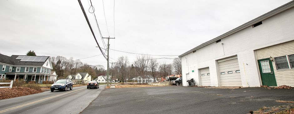 A garage, right, on a property at 136 Curtiss St. in Southington, Mon., Nov. 18, 2019. A Southington developer is requesting a zoning change for the 20-acre lot. Dave Zajac, Record-Journal