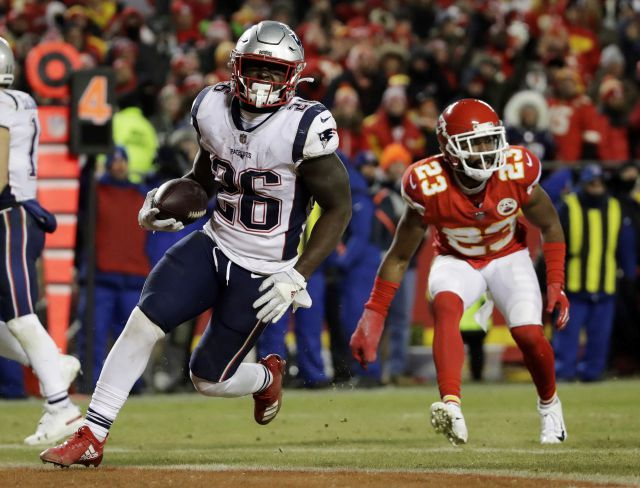 New England Patriots running back Sony Michel (26) runs to the end zone for a touchdown during the second half of the AFC Championship NFL football game against the Kansas City Chiefs, Sunday, Jan. 20, 2019, in Kansas City, Mo. (AP Photo/Elise Amendola)