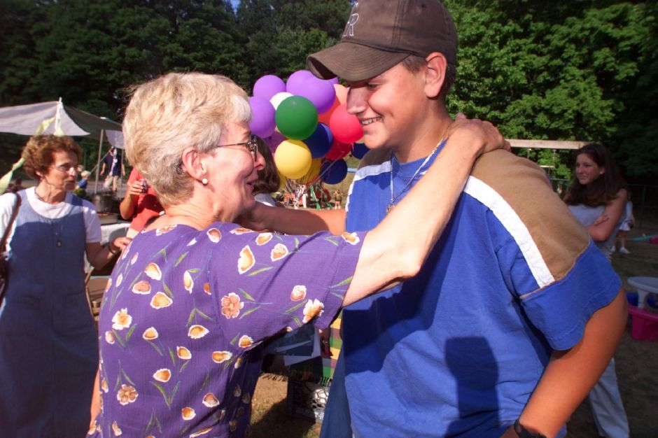 Joan Monkiewicz with David Ramonas, 13, during a 10-year-reunion at Little Wonders Day Care. Ramonas went their 10-years ago and Monkiewicz has been teaching there ever since, Aug. 1999
