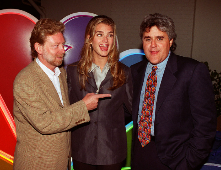 "Warren Littlefield, president of NBC entertainment, left, poses with Brooke Shields, of the television show ""Suddenly Susan,"" along with Jay Leno of ""The Tonight Show,"" during the NBC Summer Block Party for the nation"