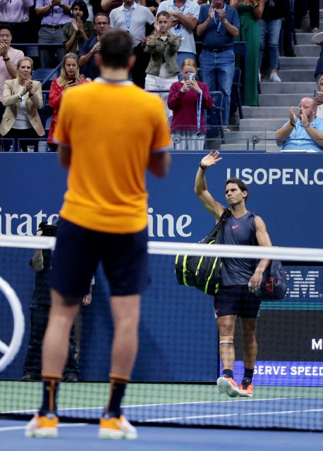 Rafael Nadal, of Spain, waves to fans after he retired from a match against Juan Martin del Potro, of Argentina, during the semifinals of the U.S. Open tennis tournament, Friday, Sept. 7, 2018, in New York. (AP Photo/Andres Kudacki)