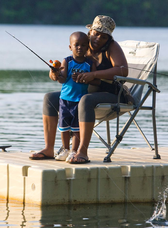 Crescent Lake ranks third on TripAdvisor.com's list of things to do in Southington. In this file photo, Nazir Russell, 3 of New Britian casts his fishing line with his mother Latasha Russell just before sunset on Saturday May 28, 2011. (Matt Andrew/ Record-Journal)