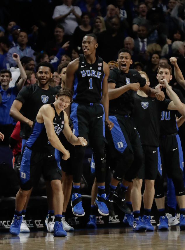 Duke players react in the closing minute of an NCAA college basketball game against Notre Dame during the championship game of the Atlantic Coast Conference tournament, Saturday, March 11, 2017, in New York. Duke won 75-69. (AP Photo/Julie Jacobson)