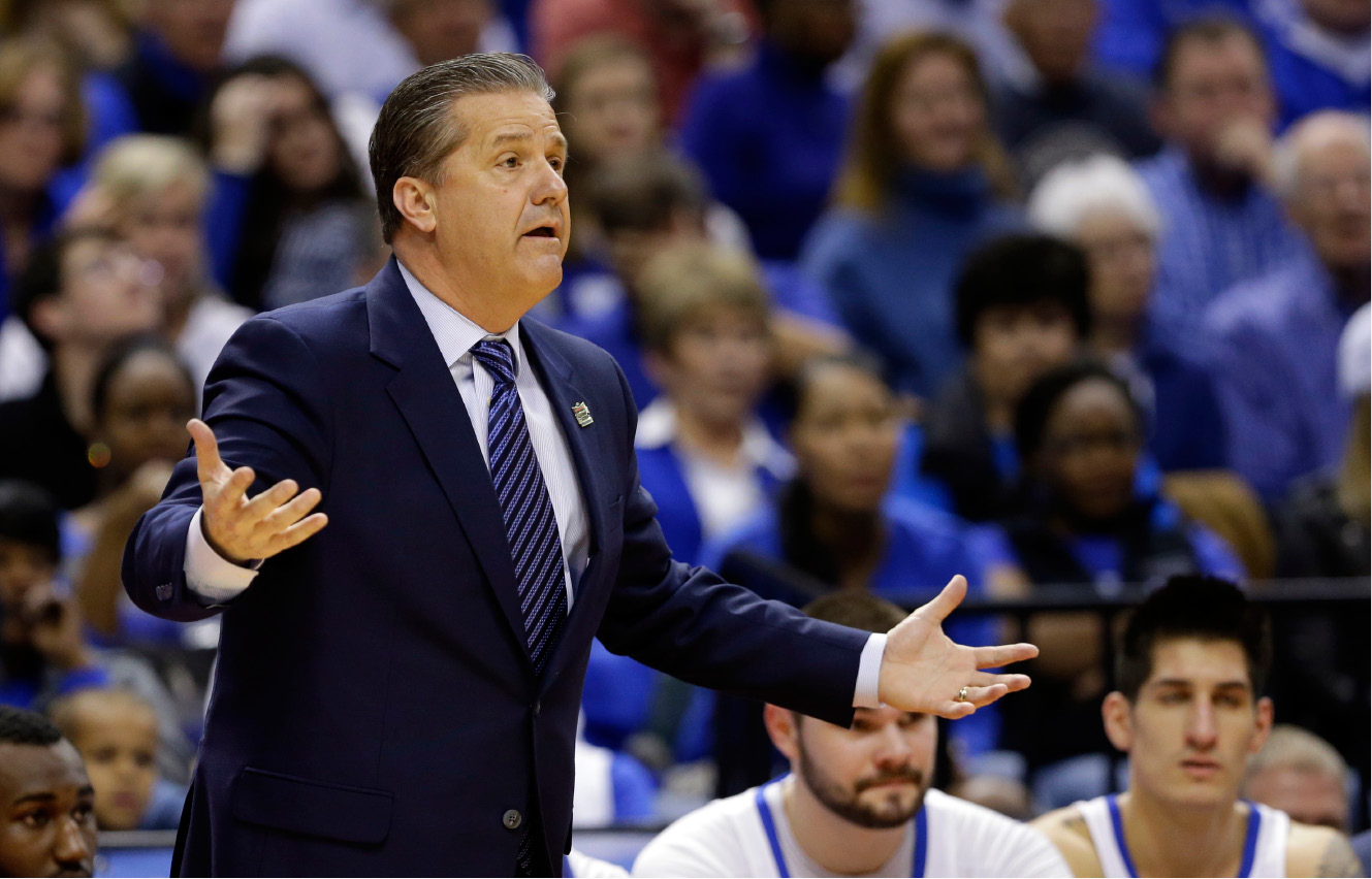 Kentucky head coach John Calipari questions a call during the first half of a second-round game against Wichita State in the mens NCAA college basketball tournament in Indianapolis, Sunday, March 19, 2017. (AP Photo/Michael Conroy)