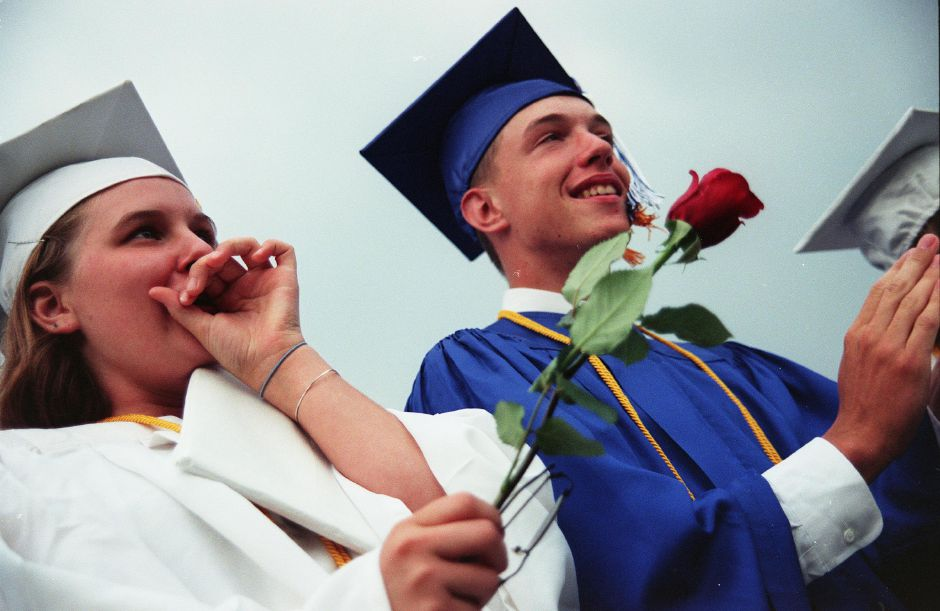 RJ file photo - Jennifer Kirstyn Buchanan, left, and Sean Richard Carr, right, cheer while diplomas are handed out at the Lyman Hall High School graduation ceremonies in Wallingford Friday June 25, 1999. Both are honor students.