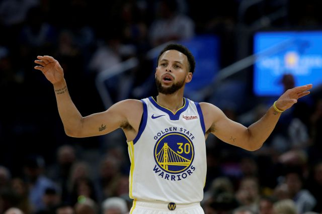 FILE - In this Oct. 5, 2019, file photo, Golden State Warriors guard Stephen Curry gestures against the Los Angeles Lakers during a preseason NBA basketball game in San Francisco. Curry knows how different this season will be. He realizes how many aren