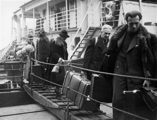 Sudeten refugees disembark at the London wharf, Oct. 31, 1938. Men with well-paying jobs could only take 25 shillings out of Czechoslovakia and most of them had only a few shillings left. (AP Photo)