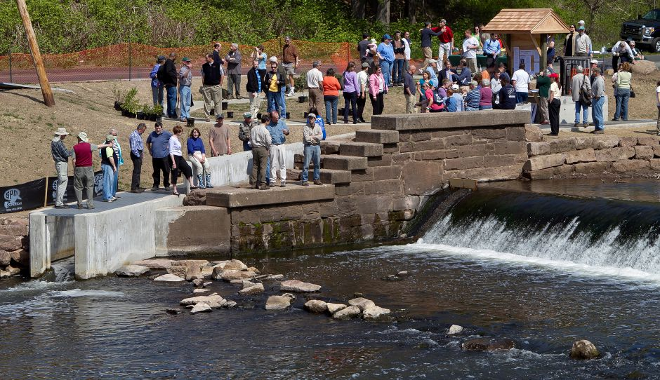 A crowd gathered for the dedication of the Harry Olav Haakonsen Fishway at Wallace Dam along the Quinnipiac River in Wallingford on April 21, 2012.Justin Weekes, Record-Journal file photo