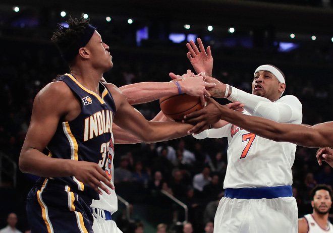 New York Knicks forward Carmelo Anthony (7) and Indiana Pacers center Myles Turner (33) vie for a rebound during the first quarter of an NBA basketball game Tuesday, Dec. 20, 2016, in New York. (AP Photo/Julie Jacobson)