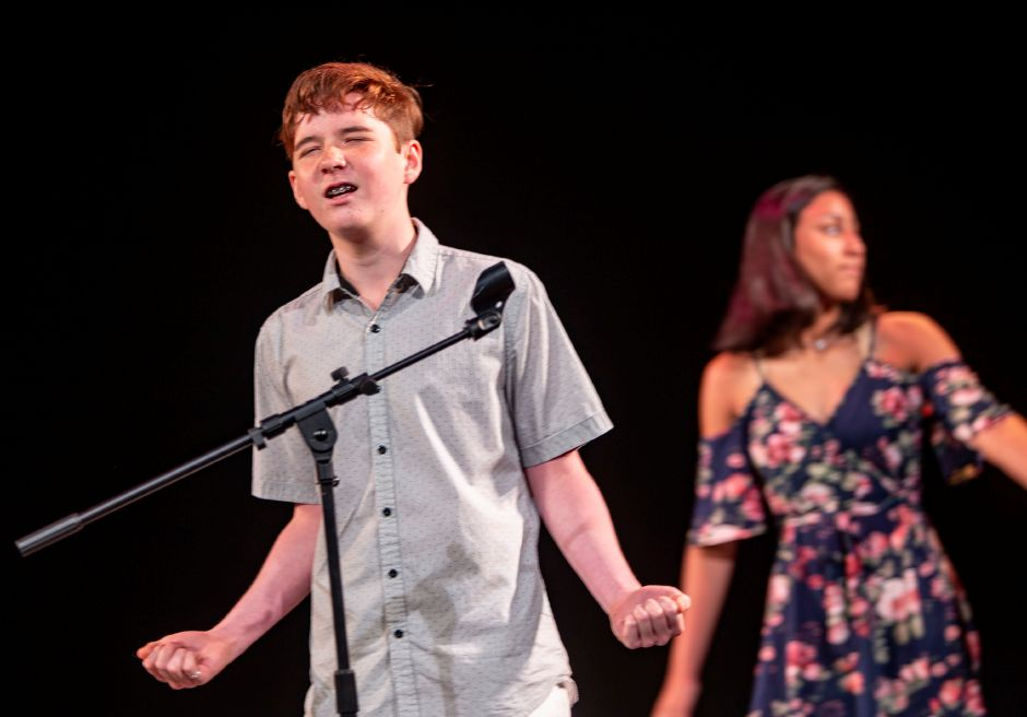 Ronan Liu, 12, gets into the song during a rehearsal of the Junior Performance Academy at Sheehan High School in Wallingford July 10, 2019. | Richie Rathsack, Record-Journal