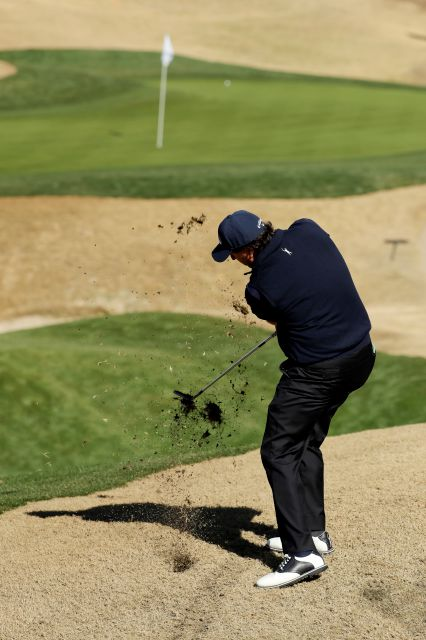 Phil Mickelson hits from rough on the second hole during the third round of the Desert Classic golf tournament on the Stadium Course at PGA West on Saturday, Jan. 19, 2019, in La Quinta, Calif. (AP Photo/Chris Carlson)