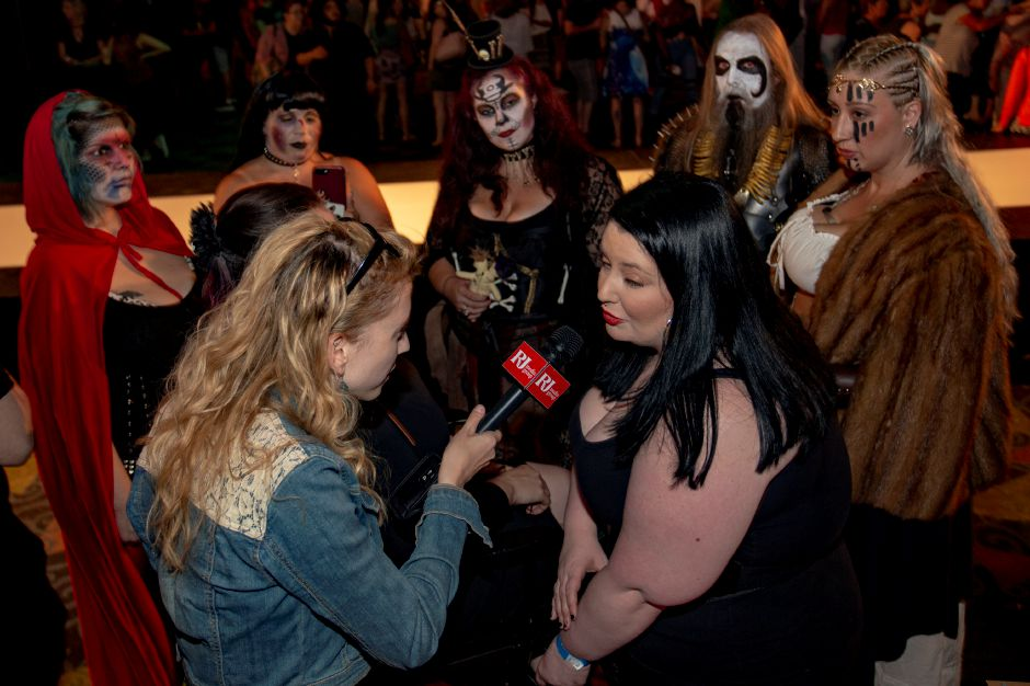 Makeup artist Rachel King talks with Record-Journal Digital Content Producer Ashley Kus about her work, surrounded by her subjects, at the RAW Artist Connect showcase at the Oakdale Theatre July 18, 2018. | Richie Rathsack, Record-Journal
