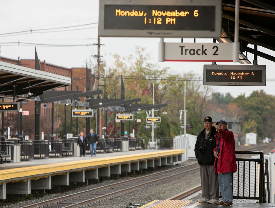 John Osmun, of Meriden, left, and Dick Otto, of Killingworth, look over the new Wallingford train station, Monday, Nov. 6, 2017. | Dave Zajac, Record-Journal