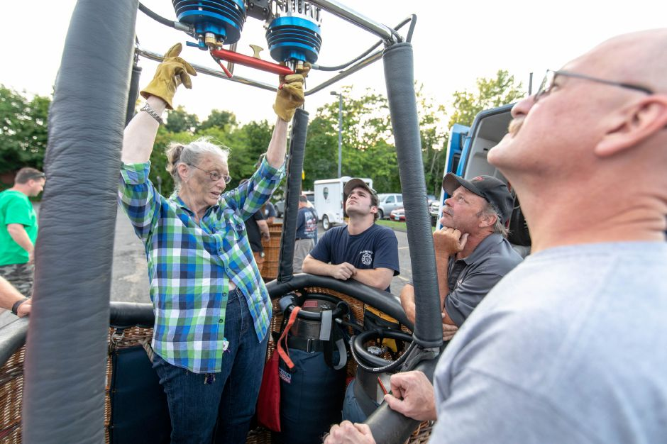 Penelope Christy gives a safety demonstration to the Plainville Fire Department on Monday  in her hot air balloon basket. The department will be hosting its annual Hot Air Balloon Festival on Aug. 23-25.