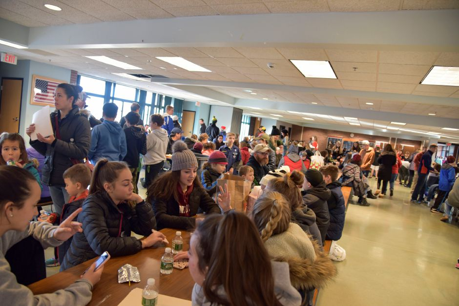 Groups at Coginchaug Regional High School get ready to go out on their pick-up routes Saturday, Dec. 1. | Bailey Wright, Town Times
