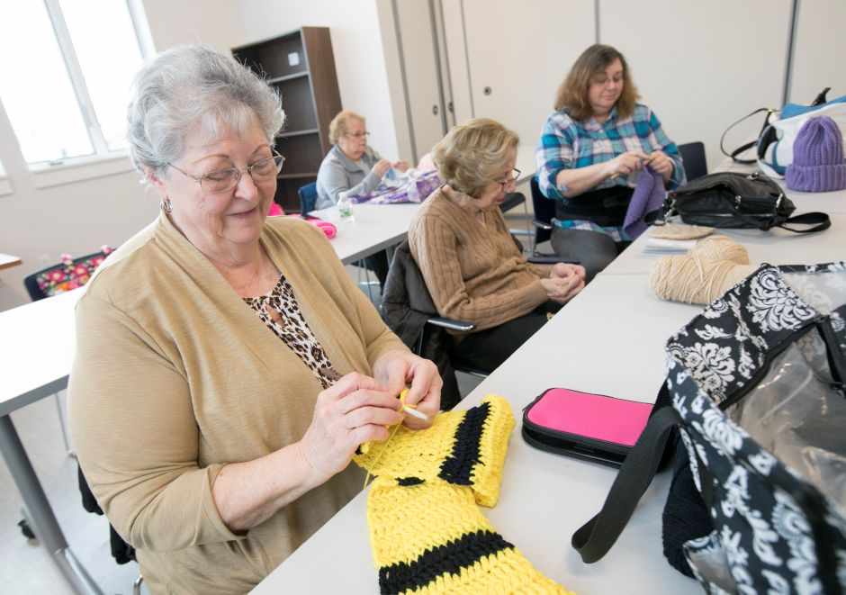 Mary Lou Klimovich, of Southington, works on a reversable scarf during the Granny Squares crocheting and knitting class in the new Calendar House in Southington on Wednesday.