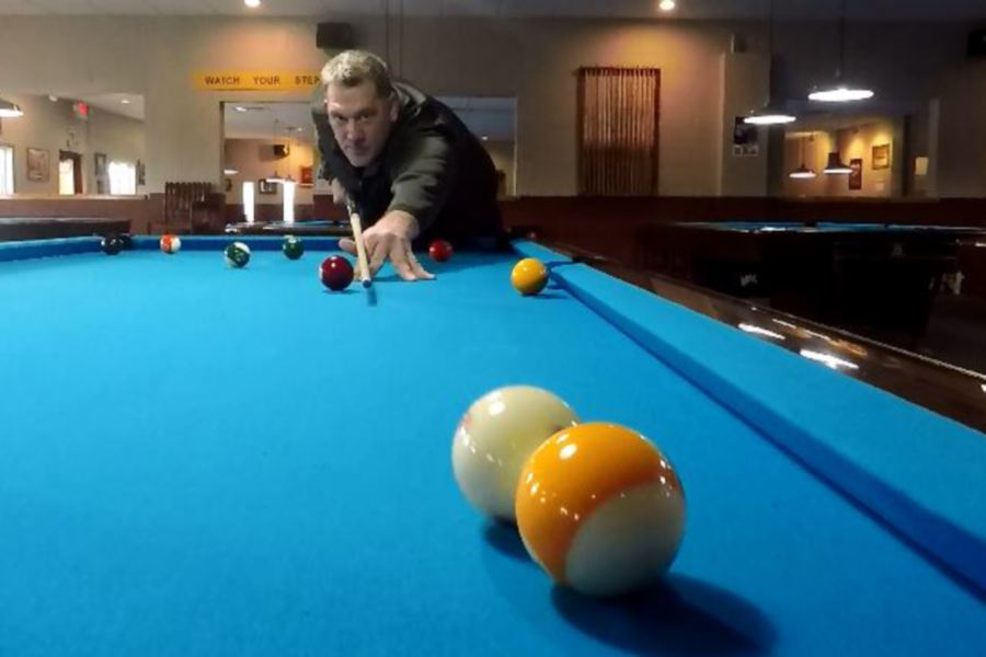 Owner Bobby Hilton plays pool at Yale Billiards' new location at 169 N Plains Industrial Rd, Wallingford. |Ashley Kus, Record-Journal