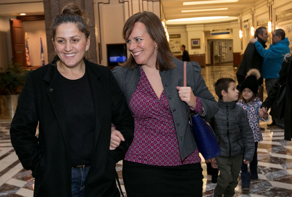 Denada Rondos, left, and attorney Erin O'Neil-Baker share smiles after a press conference at the Legislative Office Building in Hartford Monday, November 13, 2017. The Department of Homeland Security issued a forbearance that stated ICE won't act to deport Rondos while her appeal is being reviewed by the Second Circuit Court of Appeals. | Dave Zajac, Record-Journal