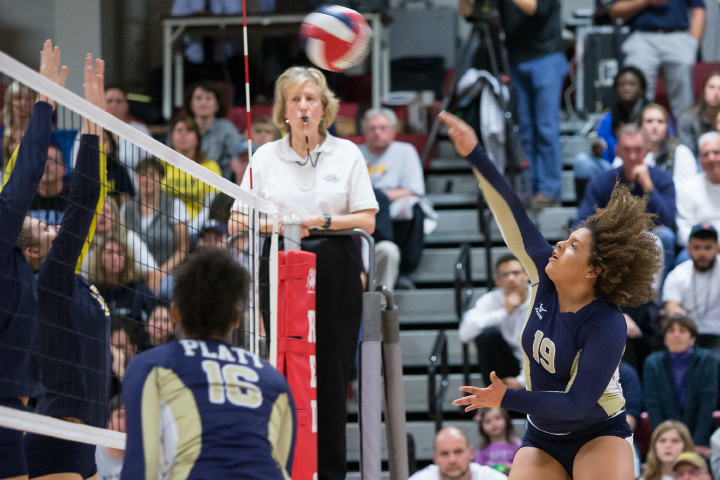 Platt's Genesis Cora-Luquis sends a spike over the RHAM blockers Saturday during the CIAC Class L state final at Berlin High School in Berlin. | Justin Weekes / For the Record-Journal