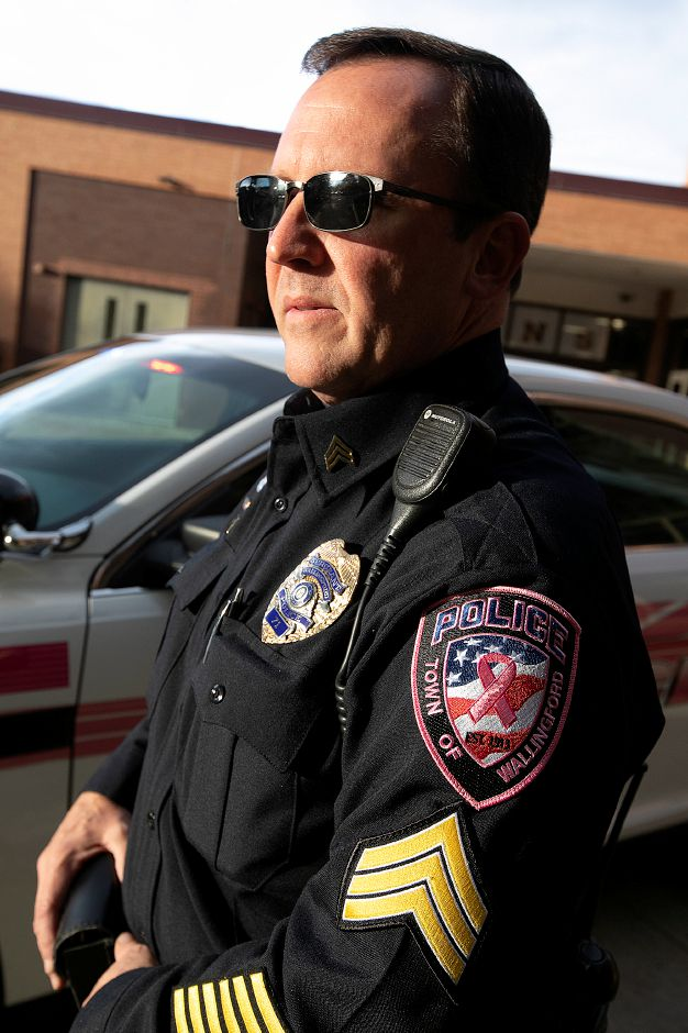 Wallingford police sport patches, sell buttons for Breast
