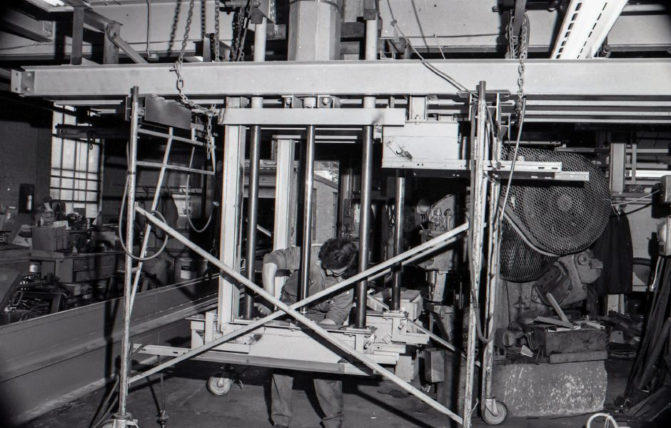 This pneumatically operated lifting section for a production monorail system is under construction at Production Equipment Co. at 401 Liberty Street.