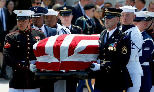 A military honor guard carries the casket of Sen. John McCain, R-Ariz., after a memorial service at North Phoenix Baptist Church Thursday, Aug. 30, 2018, in Phoenix. (AP Photo/Ross D. Franklin)