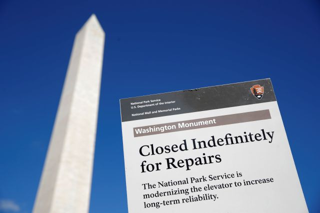 A sign greets visitors outside of the Washington Monument during a press preview tour ahead of the monument