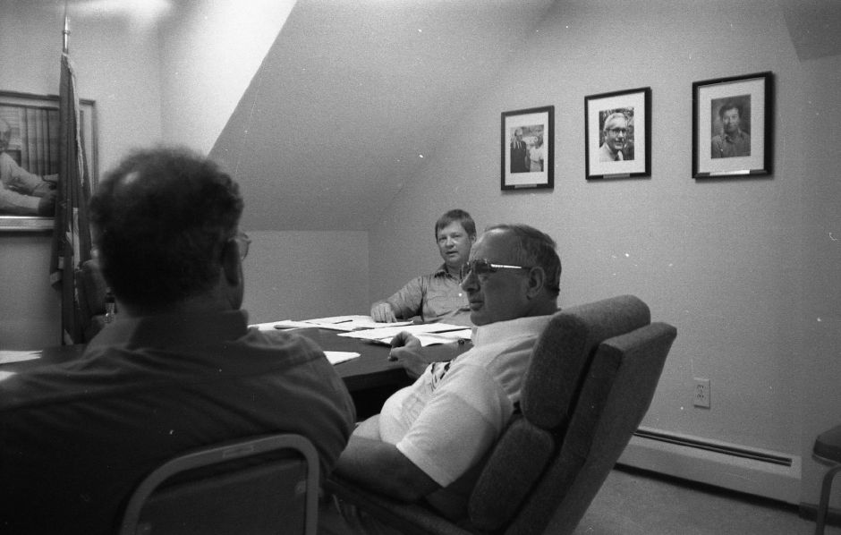 RJ file photo - Bob Parisi, center, answers questions as Nelson Kari watches during a hearin gat the Freedom of Information Commission offices, July 1989.